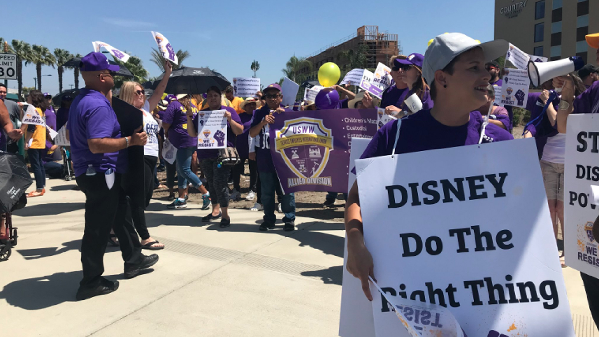 Disneyland workers protest and call for better wages on June 14, 2018. (Credit: Chip Yost/KTLA)