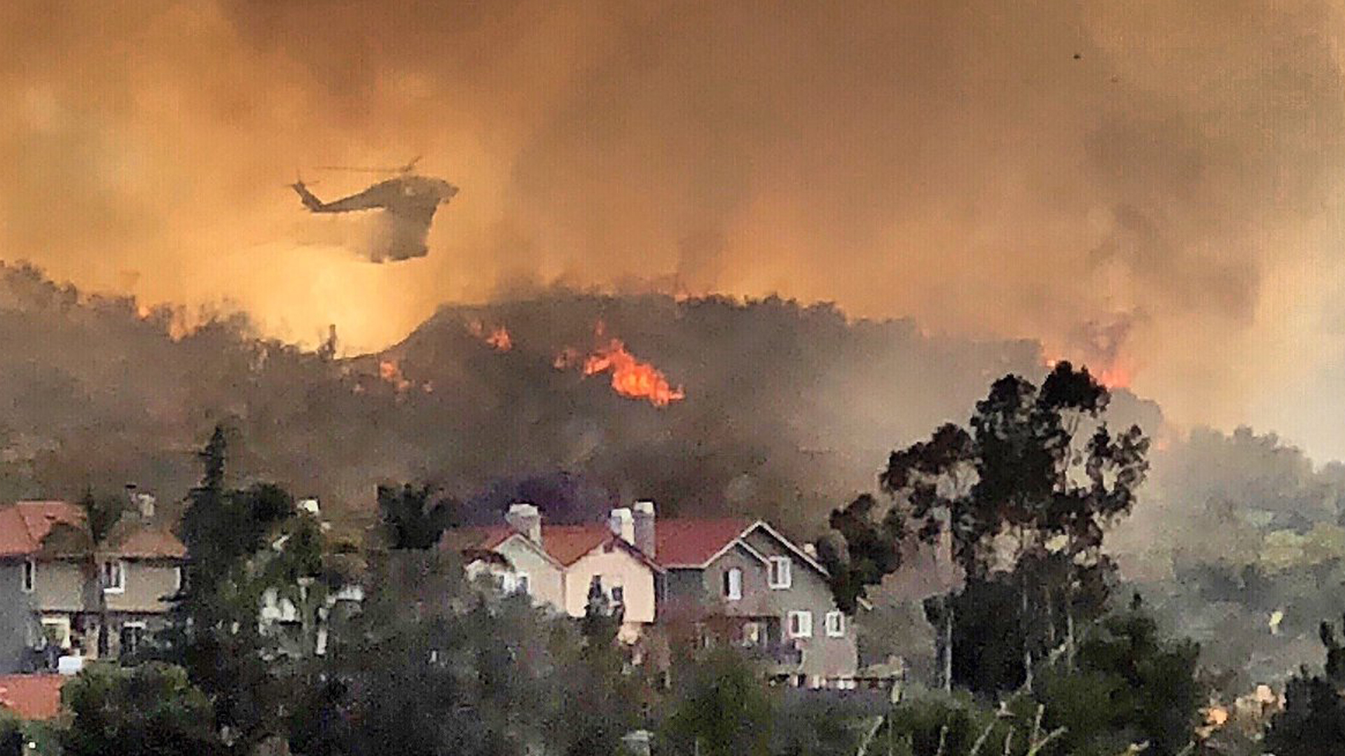 Firehawk helicopters offer air support protecting homes in Santa Clarita as the South Fire raged through the area on June 9, 2018. (Credit: Los Angeles County Fire Department Air Operations via Twitter)