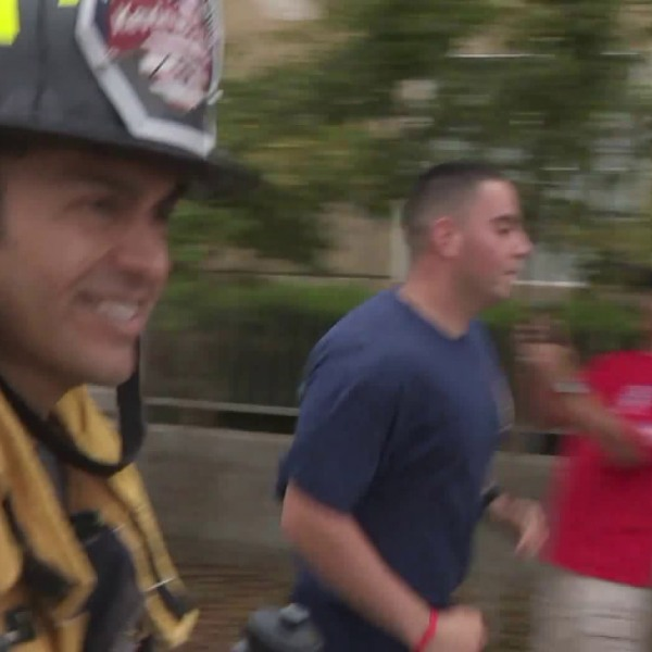 Los Angeles County firefighter Joe Zambrano runs in Bellflower on June 23, 2018. (Credit: KTLA)