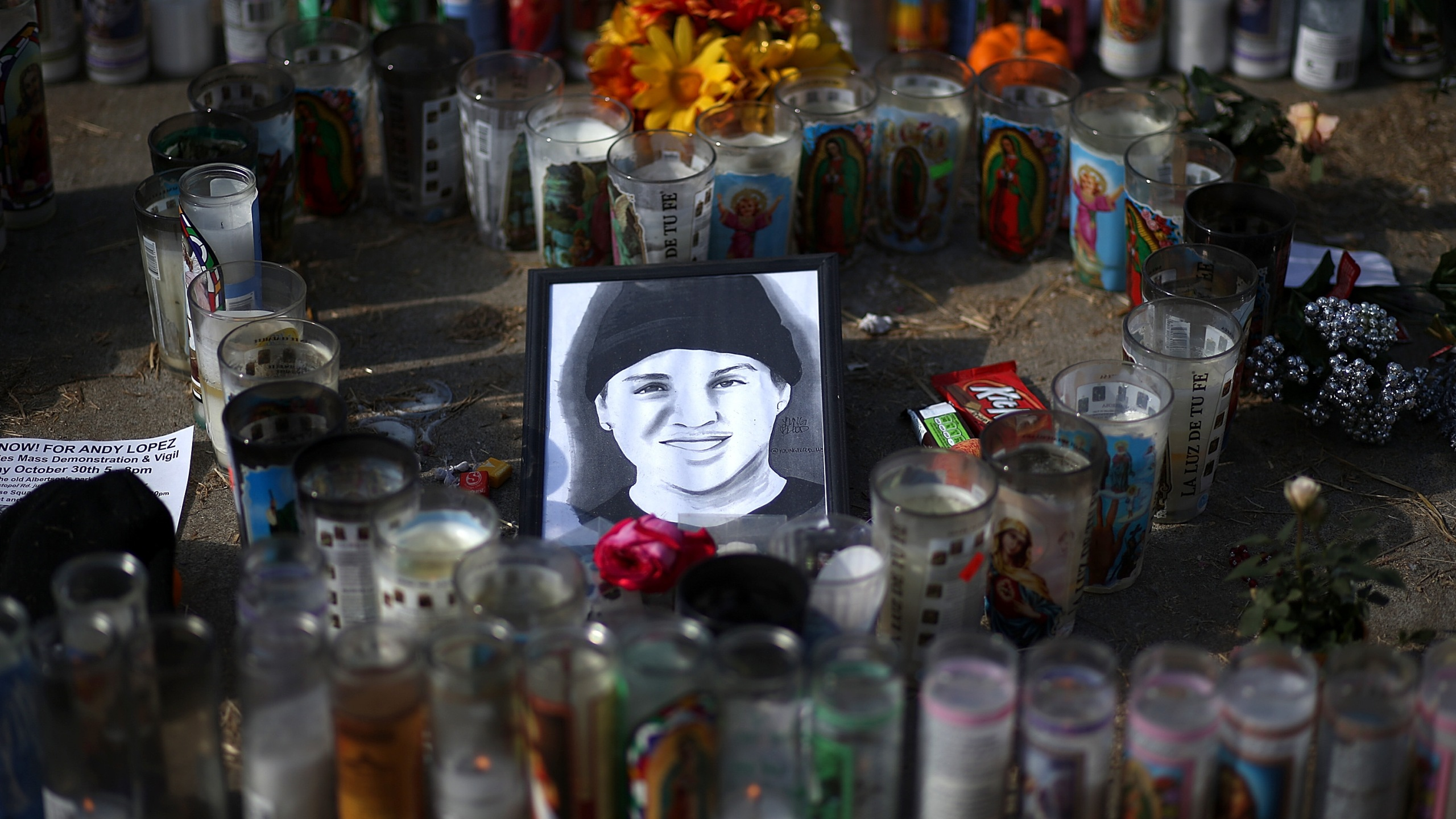 A picture of 13-year-old Andy Lopez sits with gifts and candles at a memorial in Santa Rosa on Oct. 29, 2013. (Credit: Justin Sullivan / Getty Images)