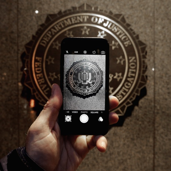 The official seal of the Federal Bureau of Investigation is seen on an iPhone's camera screen outside the J. Edgar Hoover headquarters February 23, 2016 in Washington, D.C. (Credit: Chip Somodevilla/Getty Images)