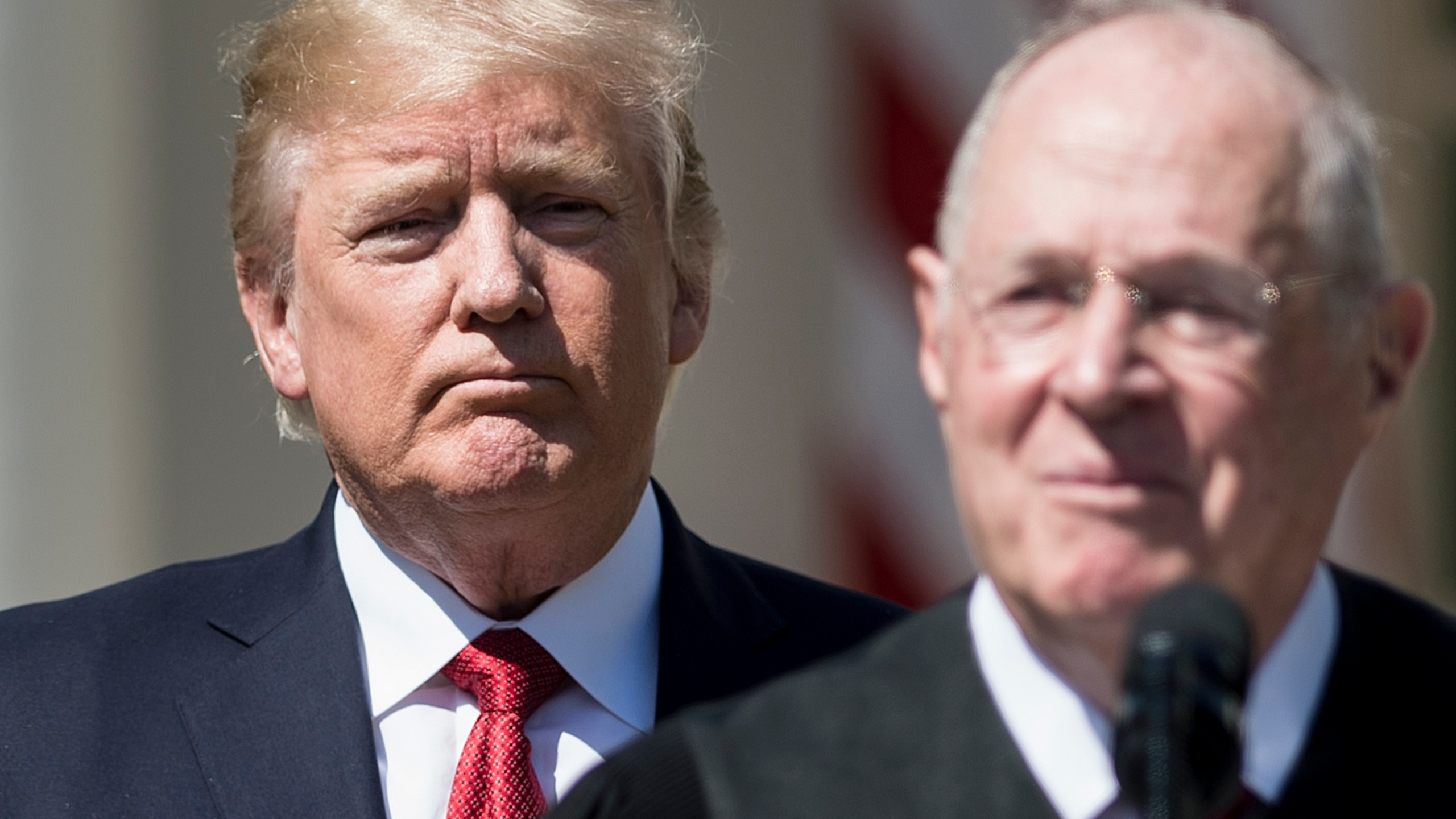 Donald Trump listens while Supreme Court Justice Anthony Kennedy speaks during a ceremony in the Rose Garden of the White House April 10, 2017 in Washington, D.C. (Credit: BRENDAN SMIALOWSKI/AFP/Getty Images)