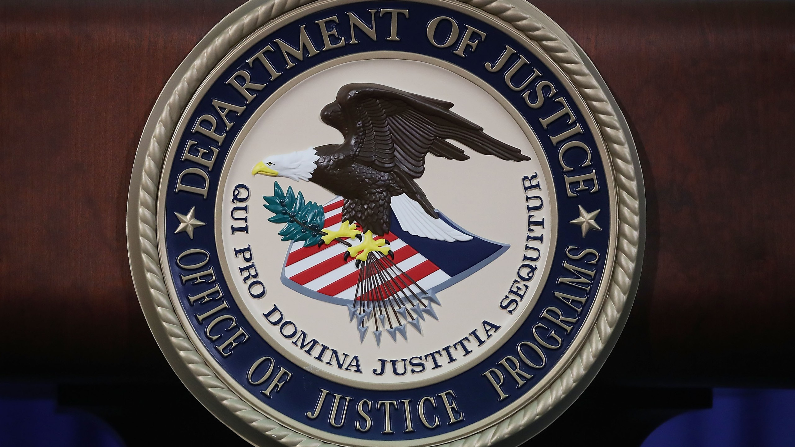 The Justice Department seal is seen on the lectern during a Hate Crimes Subcommittee summit on June 29, 2017 in Washington, D.C. (Credit: Mark Wilson/Getty Images)