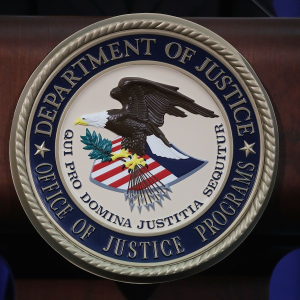 The Justice Department seal is seen on the lectern during a Hate Crimes Subcommittee summit on June 29, 2017, in Washington, D.C. (Credit: Mark Wilson/Getty Images)