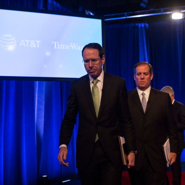 AT&T Chairman and CEO Randall Stephenson and AT&T Senior Executive Vice President David R. McAtee II leave after a news conference in Time Warner headquarters addressing the latest developments in the AT&T and Time Warner merger on Nov. 20, 2017 in New York City. (Credit: Amir Levy/Getty Images)