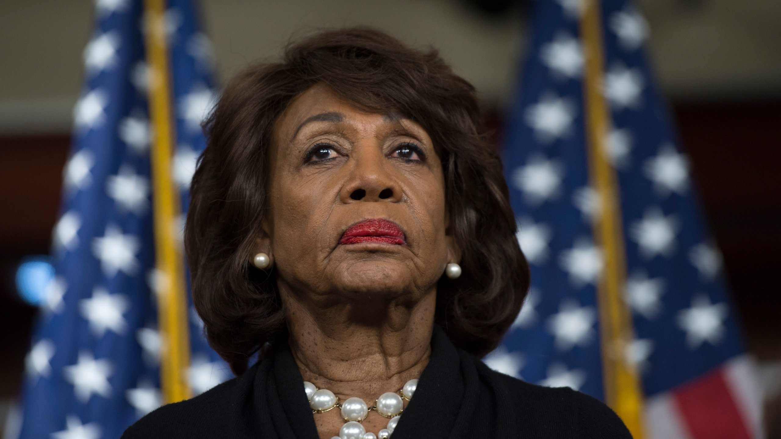 Rep. Maxine Waters looks on before speaking to reporters on Capitol Hill on Jan. 9, 2018. (Credit: Andrew Caballero-Reynolds / AFP / Getty Images)