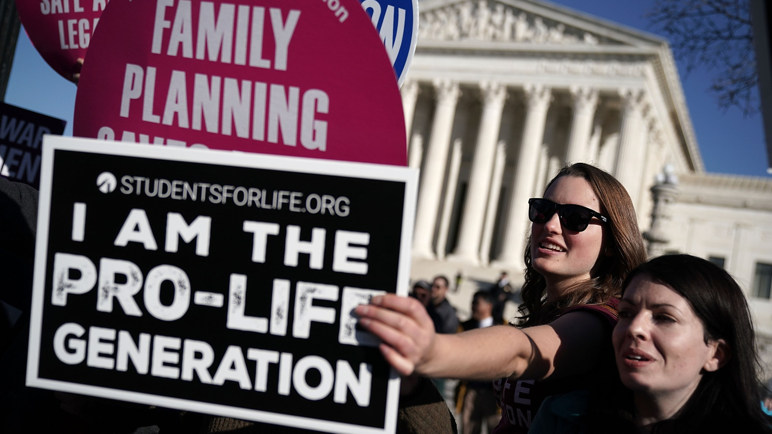 A pro-life activist tries to block the signs of pro-choice activists in front of the the U.S. Supreme Court during the 2018 March for Life January 19, 2018 in Washington, D.C. (Credit: Alex Wong/Getty Images)