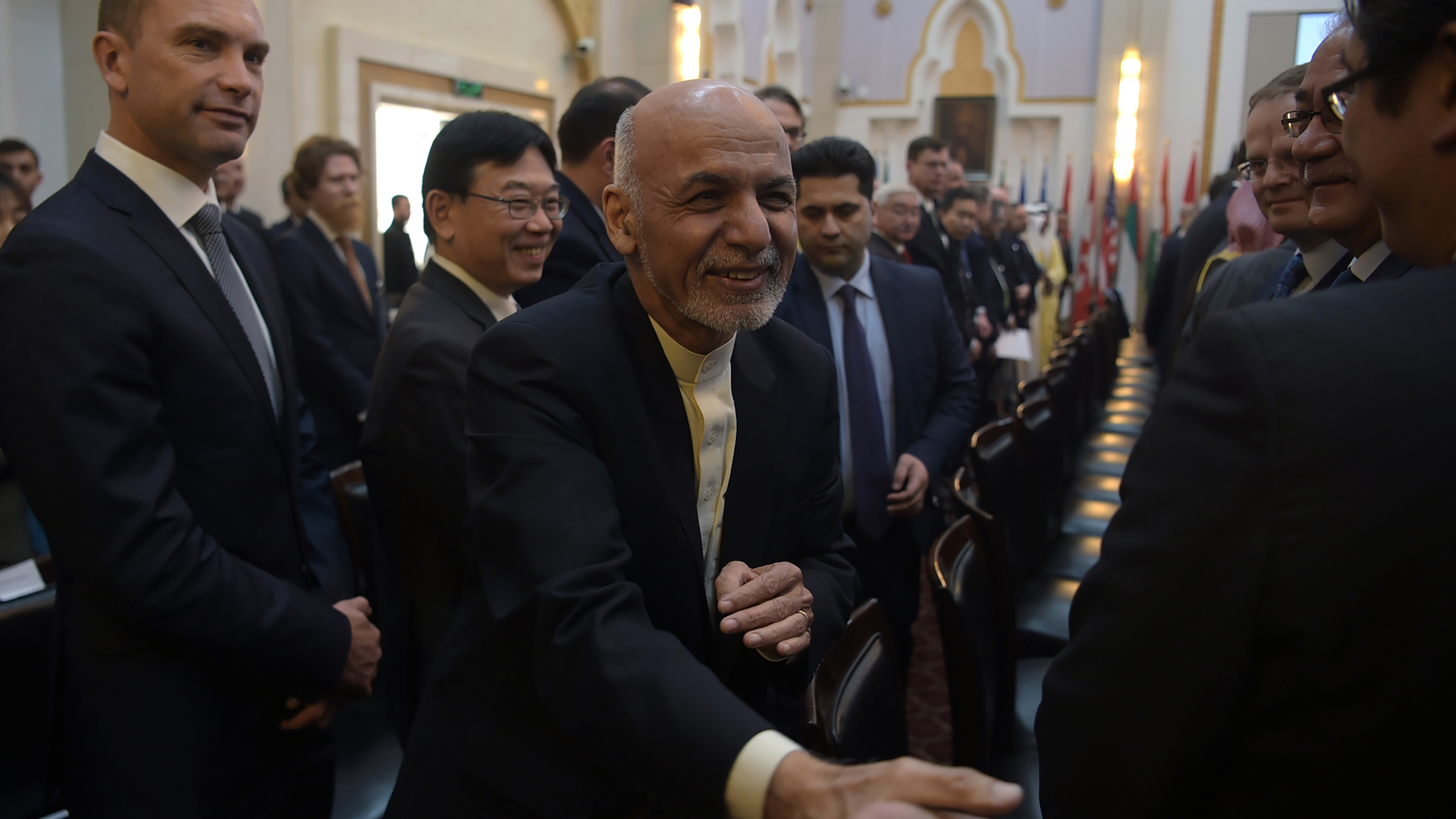Afghan President Ashraf Ghani shakes hands with a foreign delegate at the second Kabul Process conference at the Presidential Palace in Kabul on February 28, 2018. (Credit: Shah Marai ARAI/AFP/Getty Images)