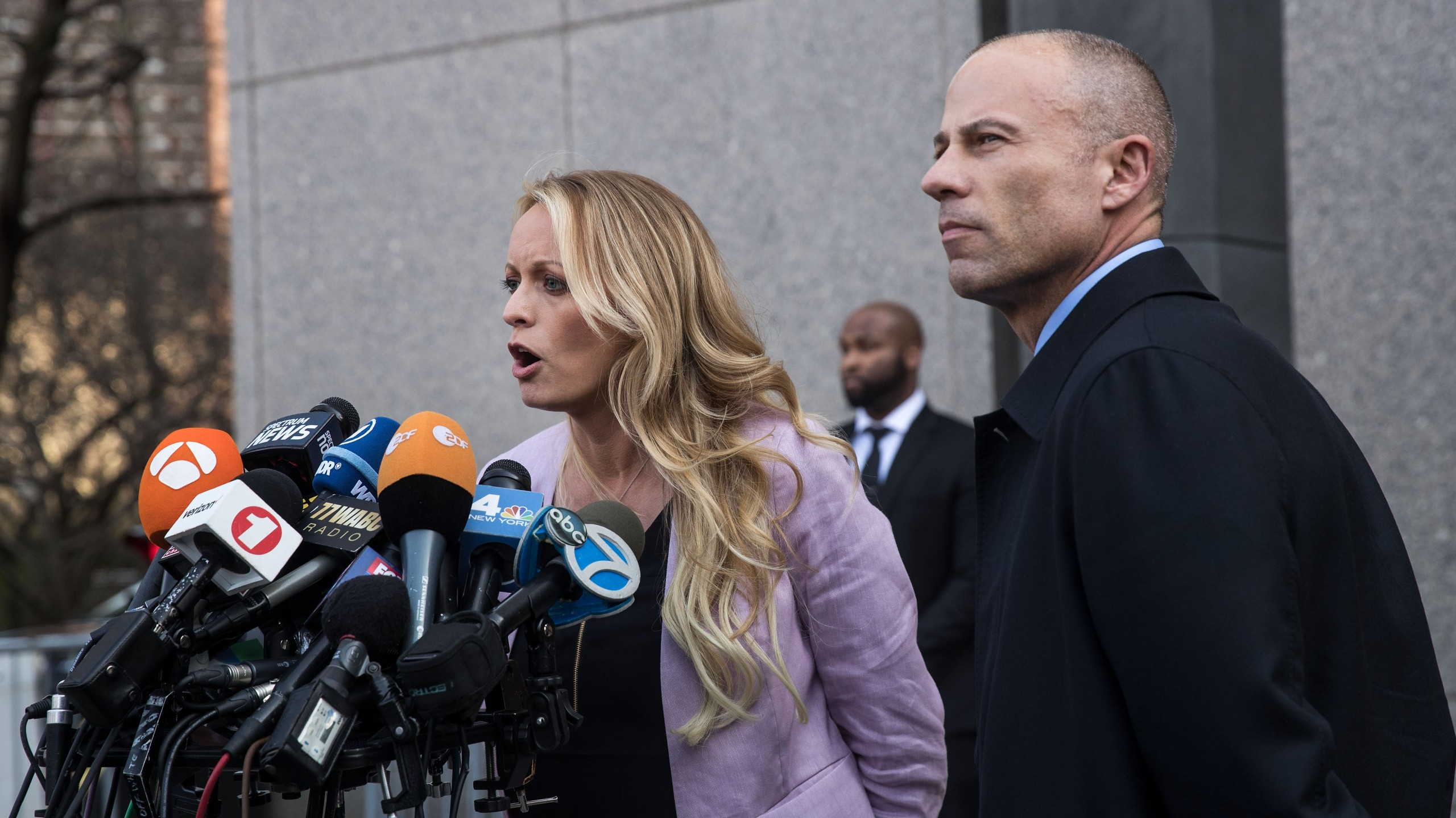 Adult film actress Stormy Daniels, whose legal name is Stephanie Clifford, and Michael Avenatti, her attorney, speak to the media as they exit the United States District Court Southern District of New York for a hearing related to Michael Cohen, President Trump's longtime personal attorney and confidante, on April 16, 2018, in New York City. (Credit: Drew Angerer/Getty Images)