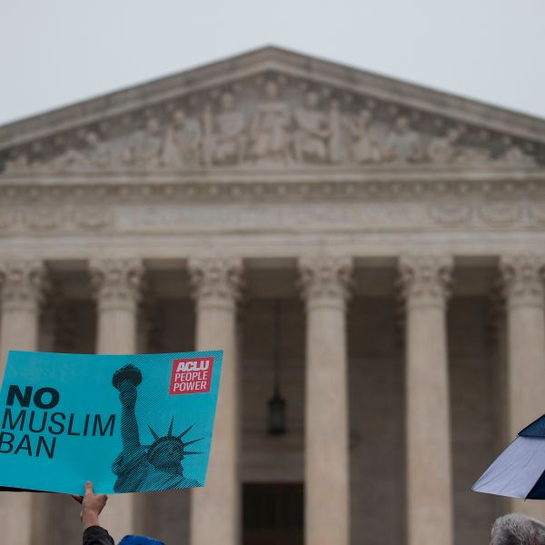 Activists rally against President Donald Trump's travel ban on April 25, 2018 — the day the Supreme Court heard arguments in Hawaii v. Trump — in front of the court in Washington, DC. (Credit: ANDREW CABALLERO-REYNOLDS / AFP / Getty Images)