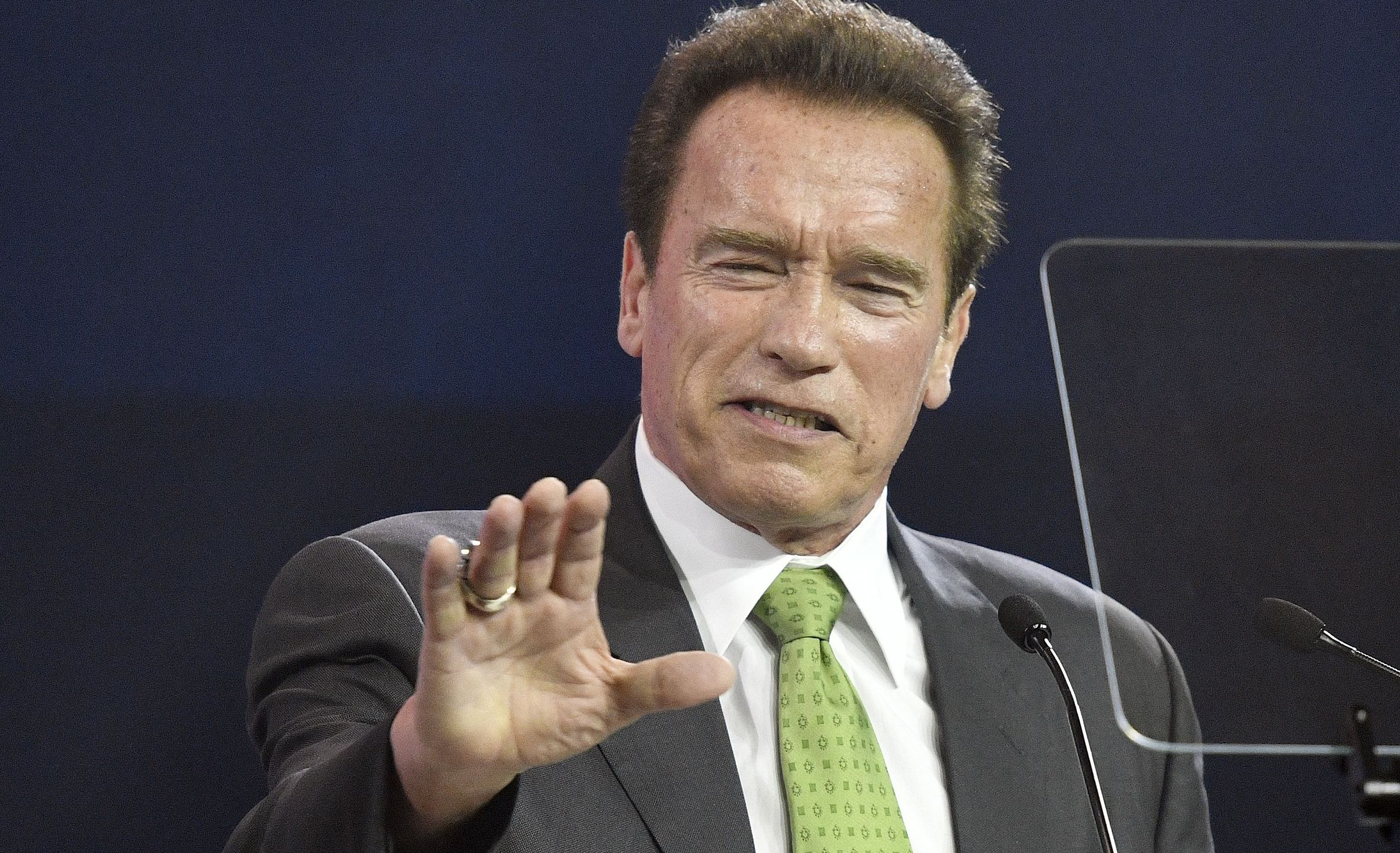 """Arnold Schwarzenegger delivers a speech during the """"R20 Austrian World Summit"""" on climate change in Vienna, Austria on May 15, 2018. (Credit: HANS PUNZ/AFP/Getty Images)"""