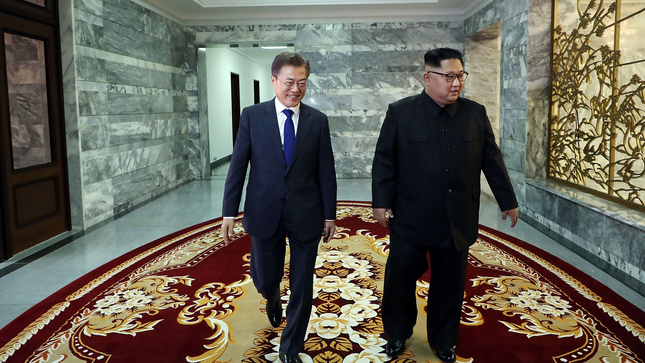 In this handout image provided by South Korean Presidential Blue House, South Korean President Moon Jae-in (left) walks with North Korean leader Kim Jong-un (right) during their meeting on May 26, 2018 in Panmunjom, North Korea. (Credit: South Korean Presidential Blue House via Getty Images)