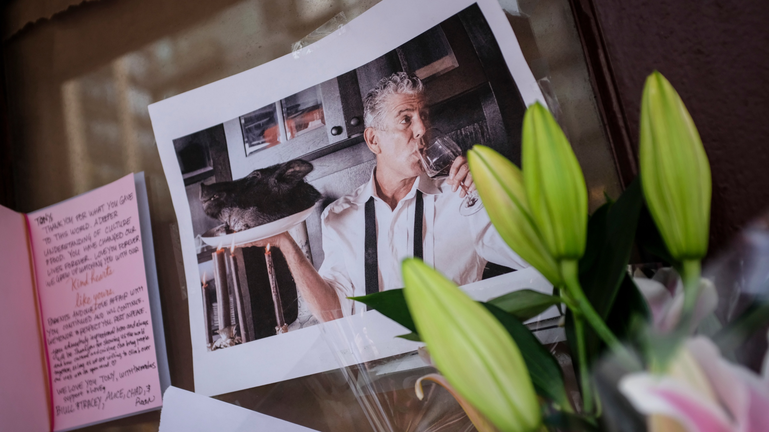 Notes, photographs and flowers are left in memory of Anthony Bourdain at the closed location of Brasserie Les Halles, where Bourdain used to work as the executive chef, June 8, 2018, in New York City. Bourdain, a writer, chef and television personality, was found dead in his hotel room in France earlier in the day.(Credit: Drew Angerer/Getty Images)