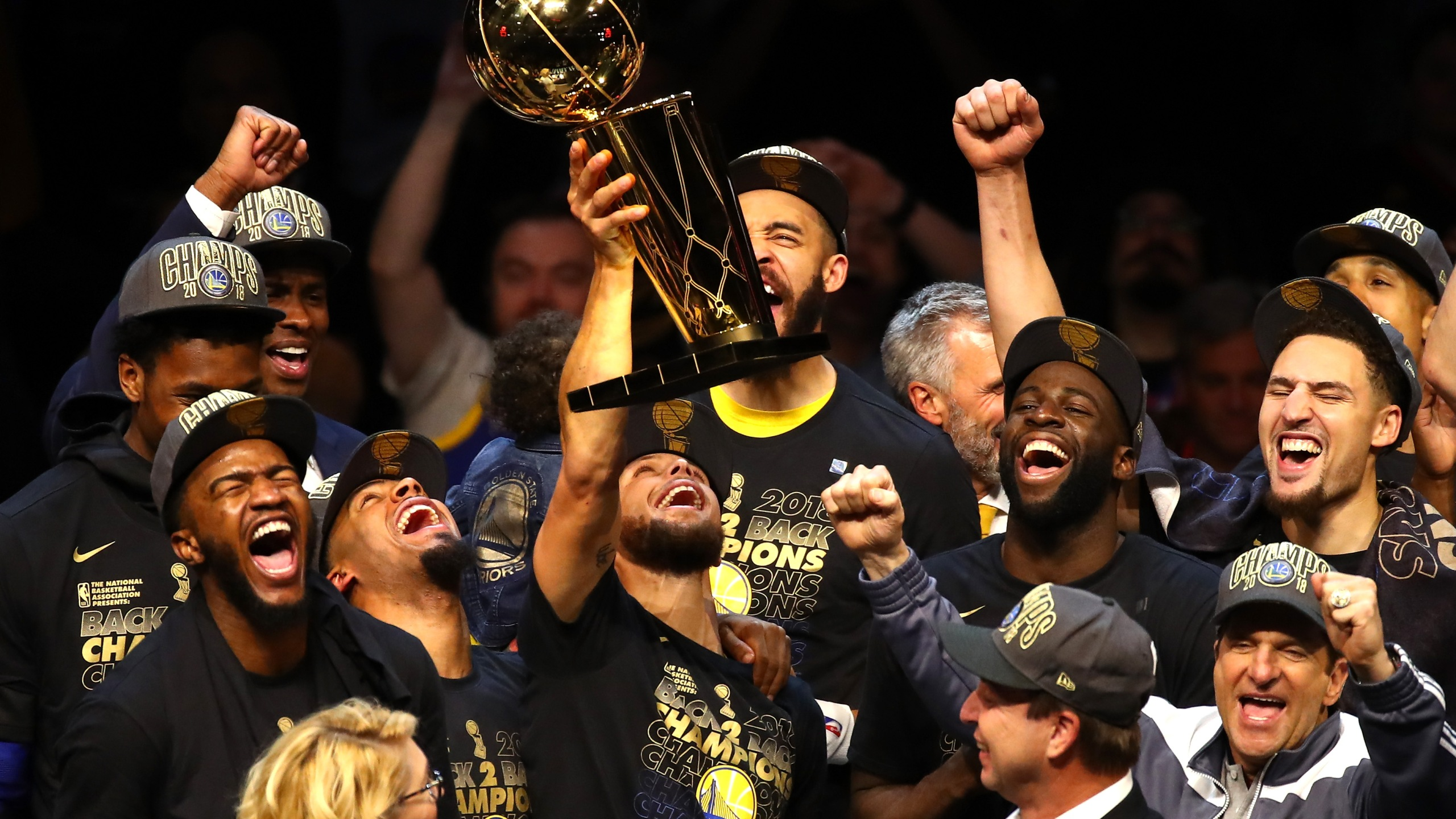 Steph Curry the Golden State Warriors celebrates with the Larry O'Brien Trophy after defeating the Cleveland Cavaliers during game four of the 2018 NBA Finals at Quicken Loans Arena on June 8, 2018 in Cleveland, Ohio. (Credit: Justin K. Aller/Getty Images)
