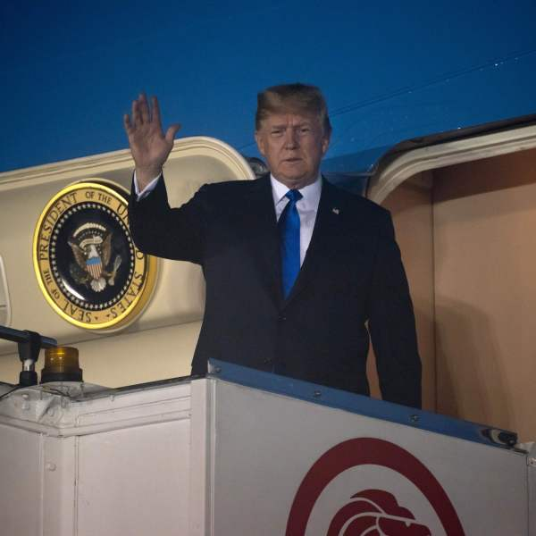 Donald Trump waves after Air Force One arrived at Paya Lebar Air Base in Singapore on June 10, 2018. (Credit: SAUL LOEB/AFP/Getty Images)