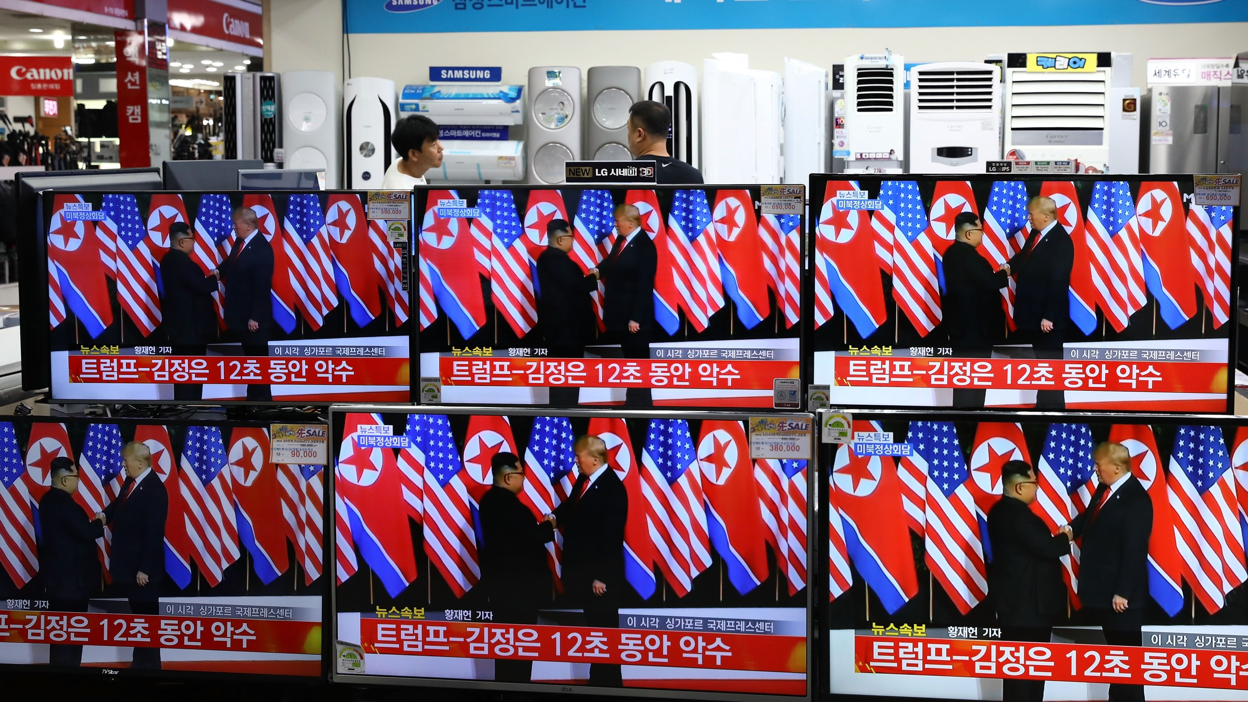 Donald Trump meeting with North Korean leader Kim Jong-un is shown on television screens at an electronics retail store in Seoul, South Korea on June 12, 2018. U.S. President Donald Trump and North Korean leader Kim Jong-un held the historic meeting on Tuesday morning in Singapore, carrying hopes of ending decades of hostility and the threat of North Korea's nuclear program. (Credit: Chung Sung-Jun/Getty Images)