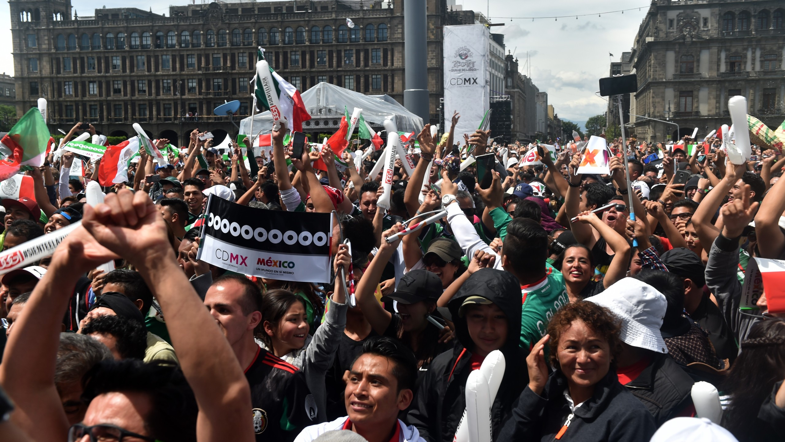 Fans of Mexico's football team celebrate during a public event at the Zocalo Square in Mexico City, on June 17 2018. (Credit: RODRIGO ARANGUA/AFP/Getty Images)
