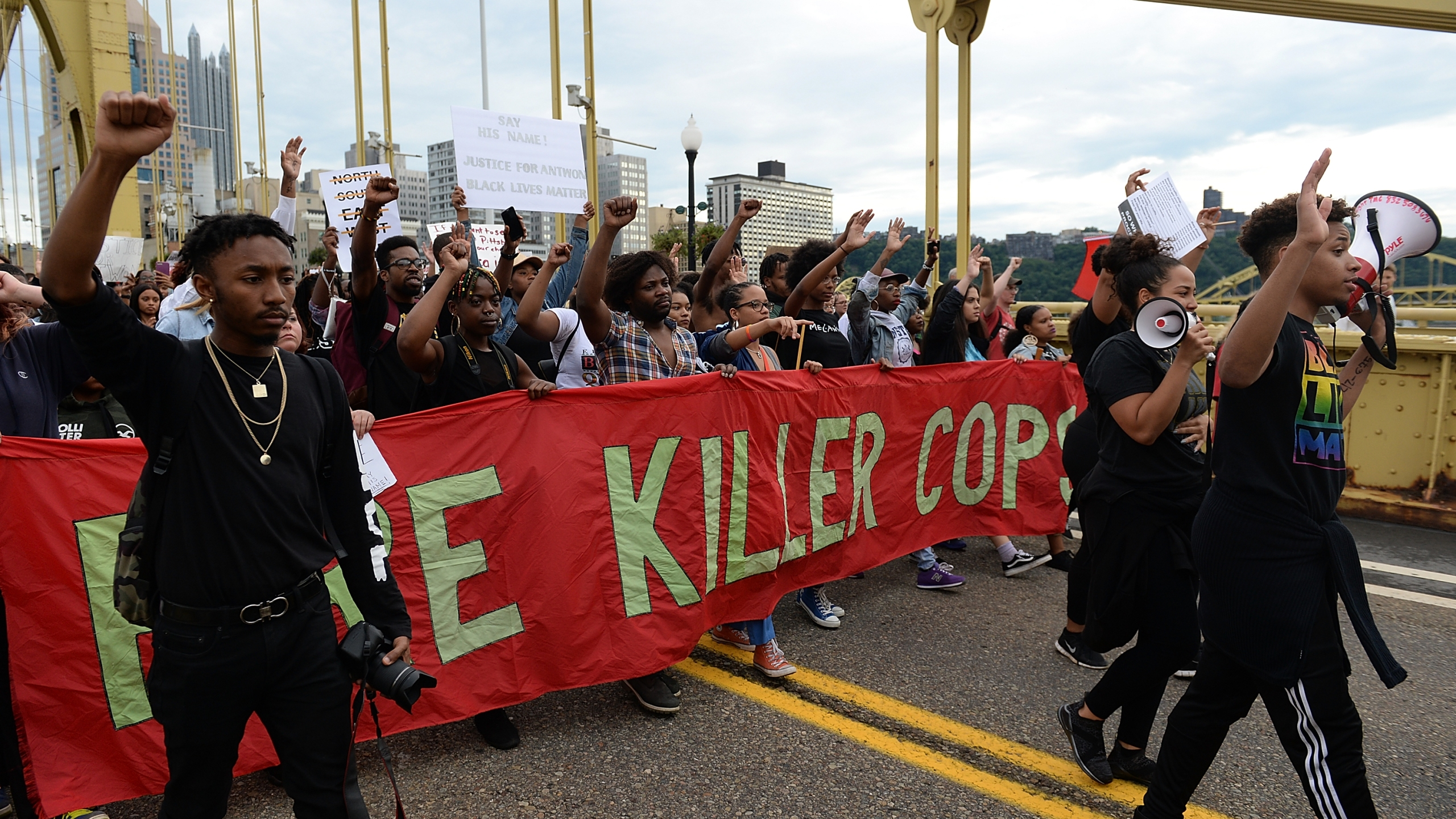 People march over the Roberto Clemente Bridge in Pittsburgh on June 22, 2018, in protest over the fatal police shooting of Antwon Rose. (Credit: Justin Berl / Getty Images)
