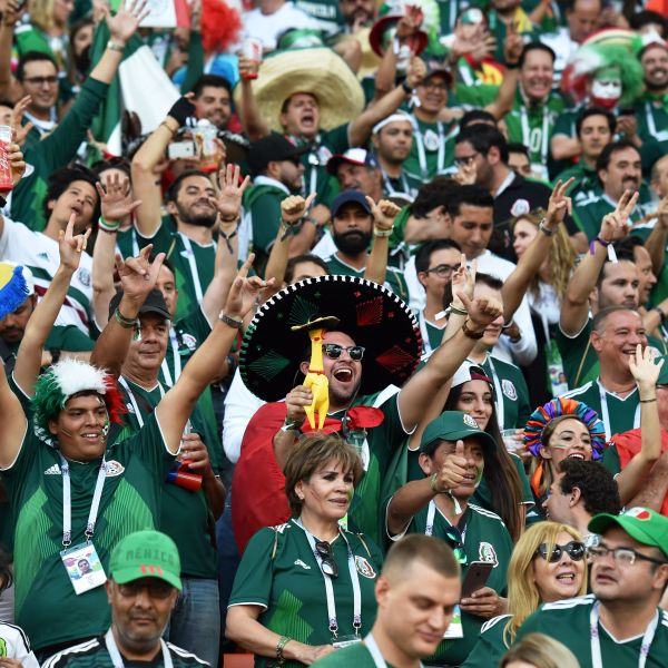 Mexico fans cheer during the World Cup match between Mexico and Sweden at the Ekaterinburg Arena on June 27, 2018. (Credit: Hector Retamal / AFP / Getty Images)