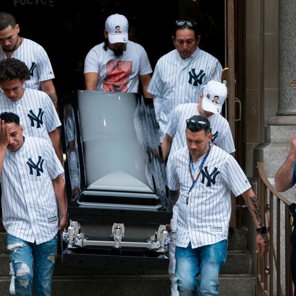 "The body of of Lesandro ""Junior"" Guzman-Feliz is taken from the Our Lady of Mount Carmel church in the Bronx after funeral services on June 27, 2018. (Credit: Don Emmert / AFP / Getty Images)"