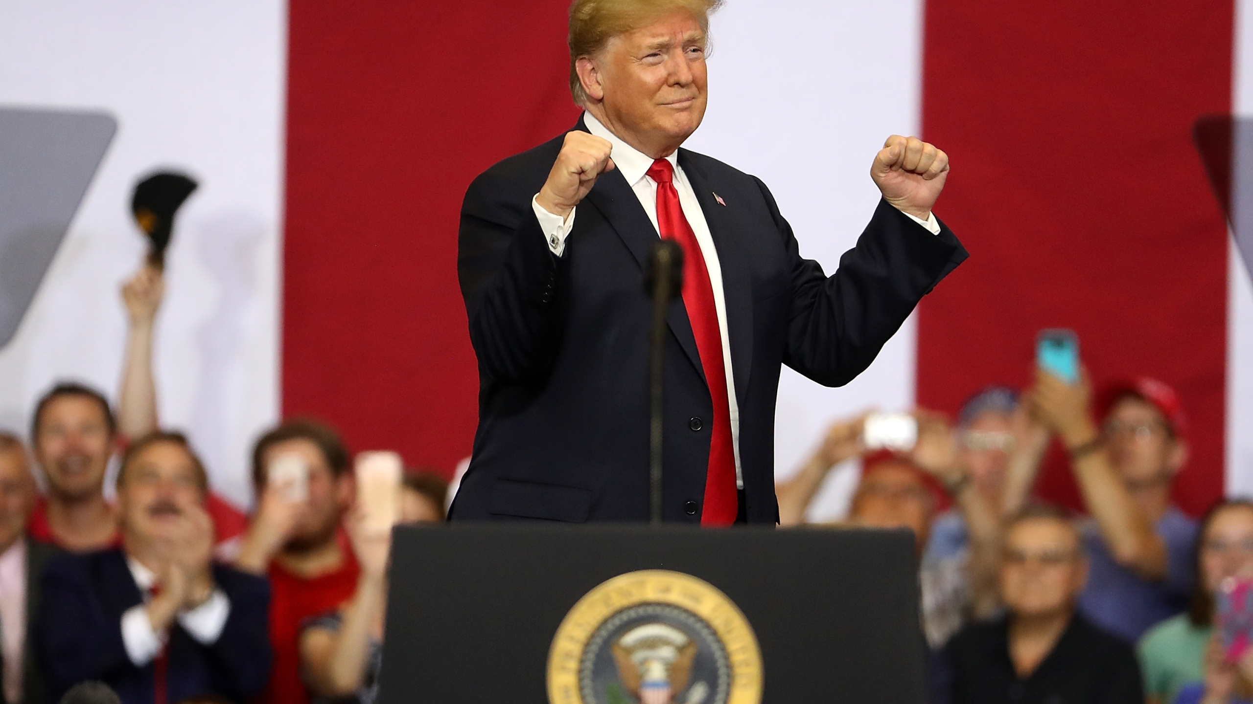 Donald Trump greets supporters during a campaign rally at Scheels Arena on June 27, 2018 in Fargo, North Dakota. (Credit: Justin Sullivan/Getty Images)