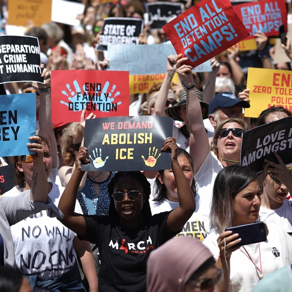 Protesters march from Freedom Plaza to demonstrate against family detentions and to demand the end of criminalization of asylum seekers on June 28, 2018, in Washington, DC. (Credit: Win McNamee / Getty Images)