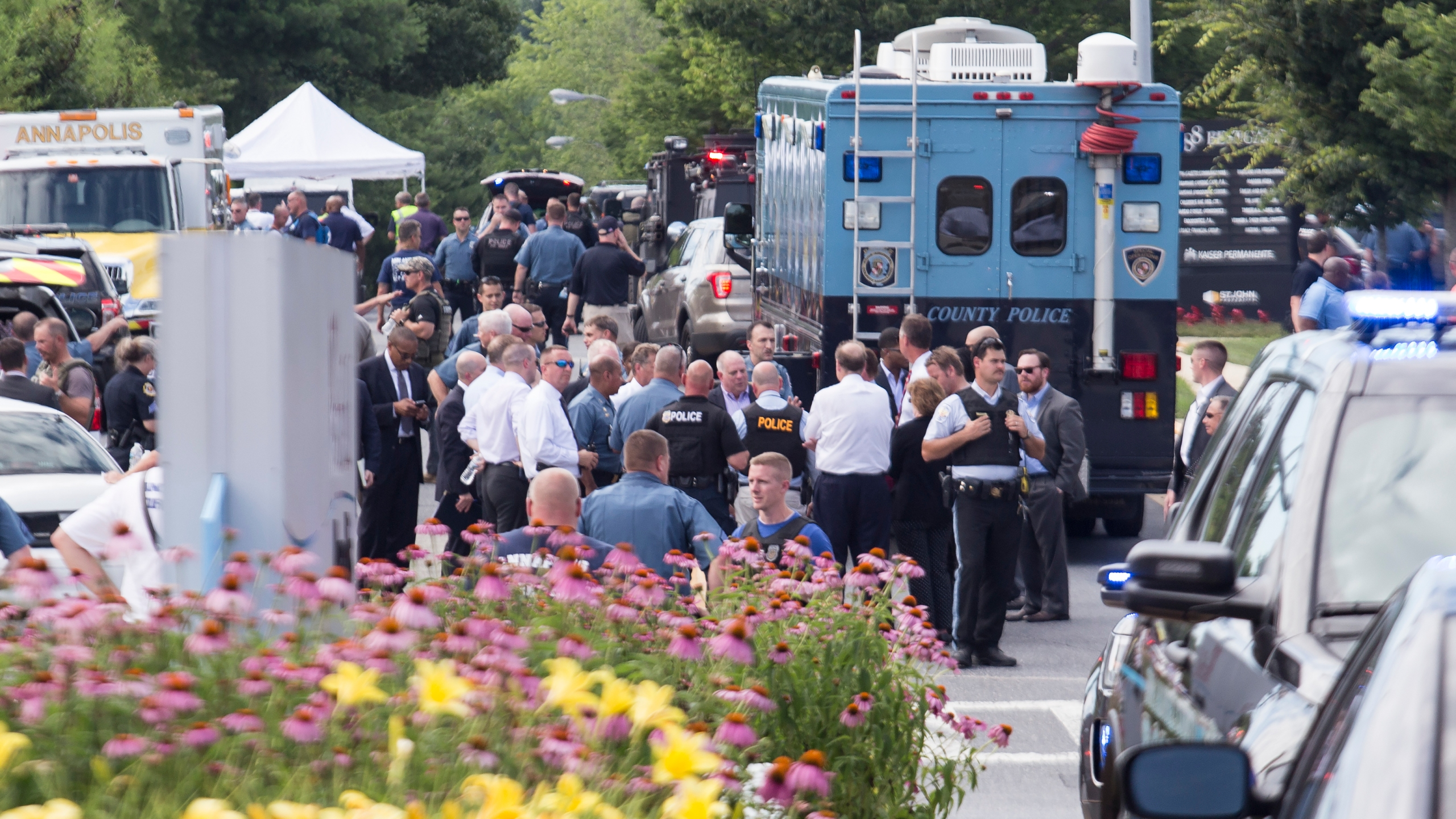 Emergency personnel congregate outside the Capital Gazette newspaper building on June 28, 2018 in Annapolis, Maryland. Five people were killed when a gunman opened fire in the newsroom. (Credit: Alex Wroblewski/Getty Images)