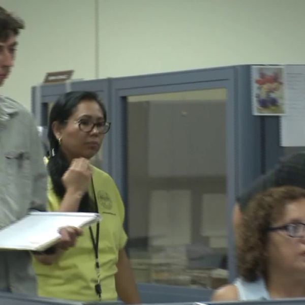 Employees are seen watching over the counting of votes in Orange County on June 6, 2018. (Credit: KTLA)