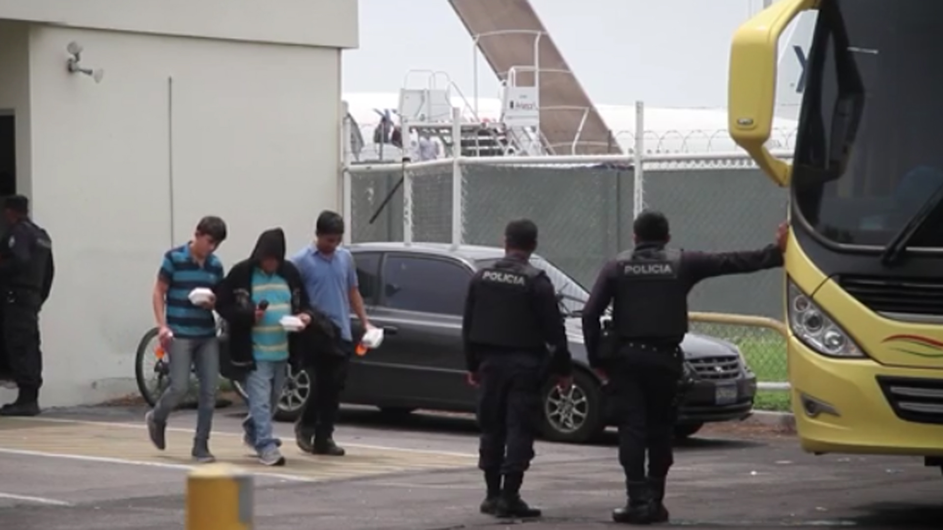 Salvadorans deported from the U.S. return home in this undated photo. (Credit: CNN)