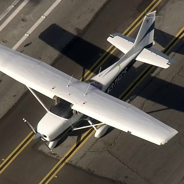 Sky5 shows a single-engine Cessna that landed on Hamilton Avenue in Huntington Beach on June 1, 2018. (Credit: KTLA)