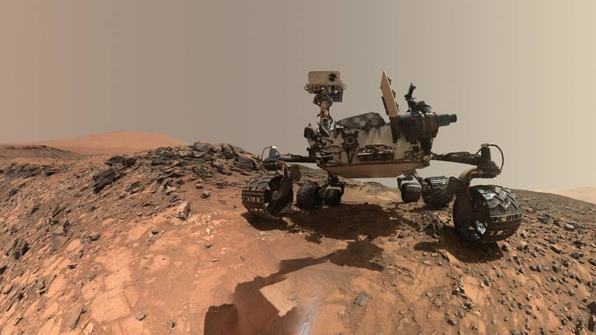 NASA's Curiosity Mars rover is seen at the site from which it reached down to drill into a rock target on lower Mount Sharp. (Credit: NASA/JPL-Caltech/MSSS)