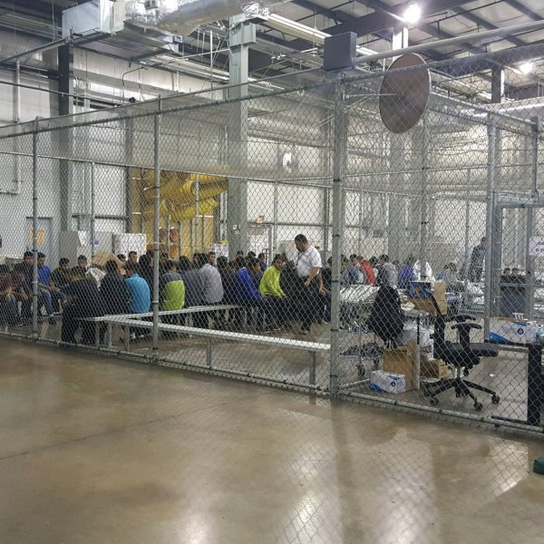 The warehouse-like facility has holding pens made from chain-link fences on the inside separating the immigrants. (Credit: US Customs and Border Patrol)