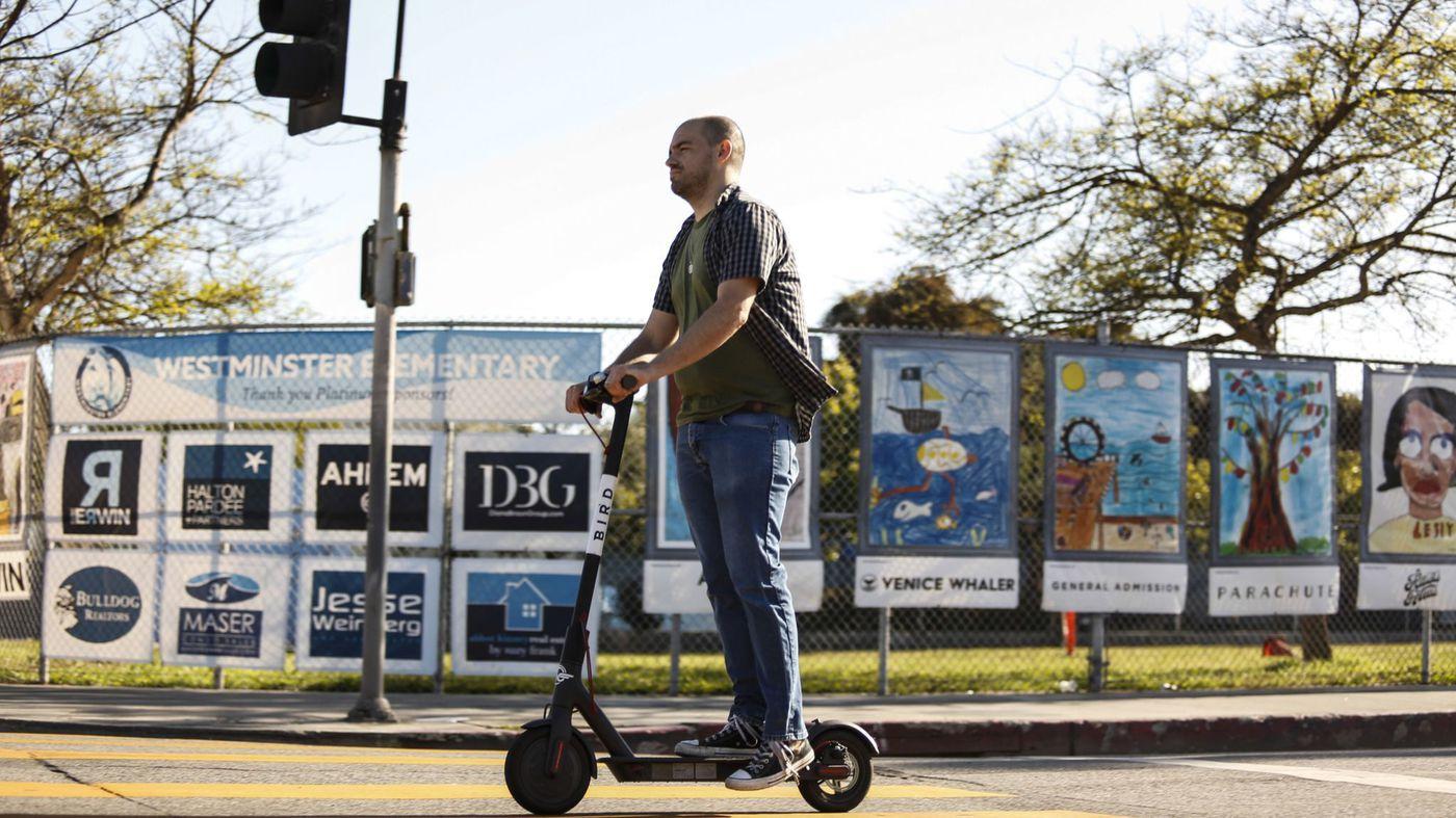 An undated photo shows a man using a rental scooter in Santa Monica. (Credit: Maria Alejandra Cardona / Los Angeles Times)