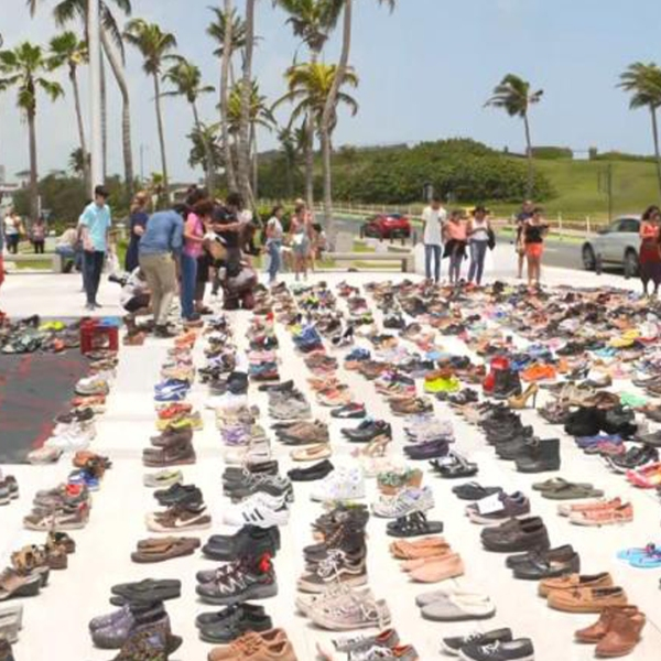 Hundreds of shoes are used to create a makeshift memorial for the victims of Hurricane Maria on June 2, 2018. (Credit: CNN)