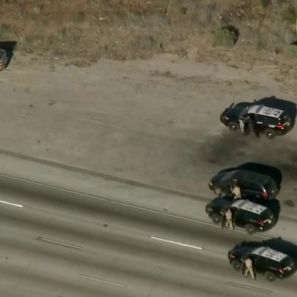 Authorities approach a U-Haul truck following a chase across the Inland Empire on June 13, 2018. (Credit: KTLA)