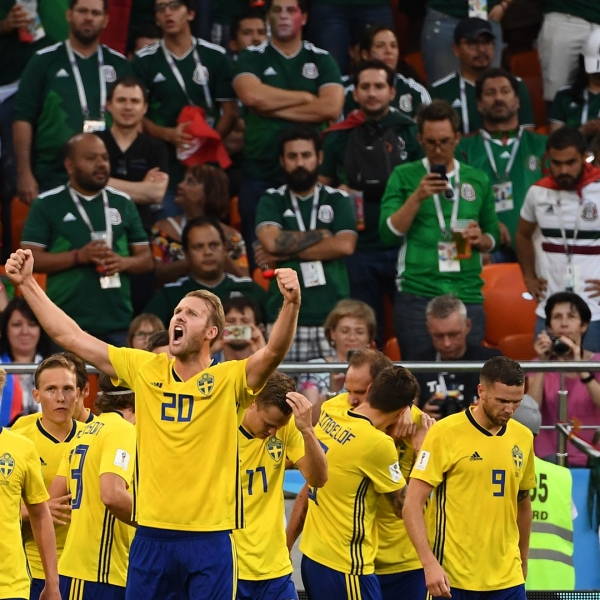 Sweden's players celebrate the team's second goal scored from the penalty spot during the Russia 2018 World Cup Group F football match between Mexico and Sweden at the Ekaterinburg Arena in Ekaterinburg on June 27, 2018. (Credit: ANNE-CHRISTINE POUJOULAT/AFP/Getty Images)