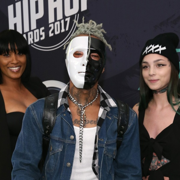 Rapper XXXTentacion, center, attended the BET Hip Hop Awards 2017 at The Fillmore Miami Beach at the Jackie Gleason Theater on October 6, 2017 in Miami Beach, Florida. (Credit: Bennett Raglin/Getty Images for BET )