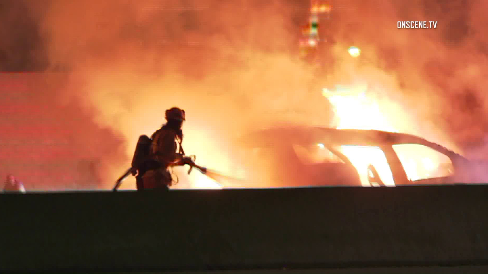 Firefighters respond to a fatal crash on the 605 Freeway in Norwalk on July 16, 2018. (Credit: OnScene.TV)