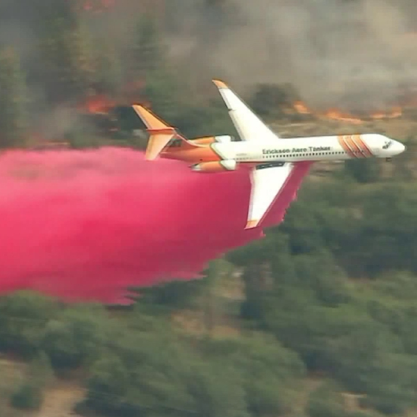 An air tanker drops retardant on the Cranston Fire on July 27, 2018. (Credit: KTLA)