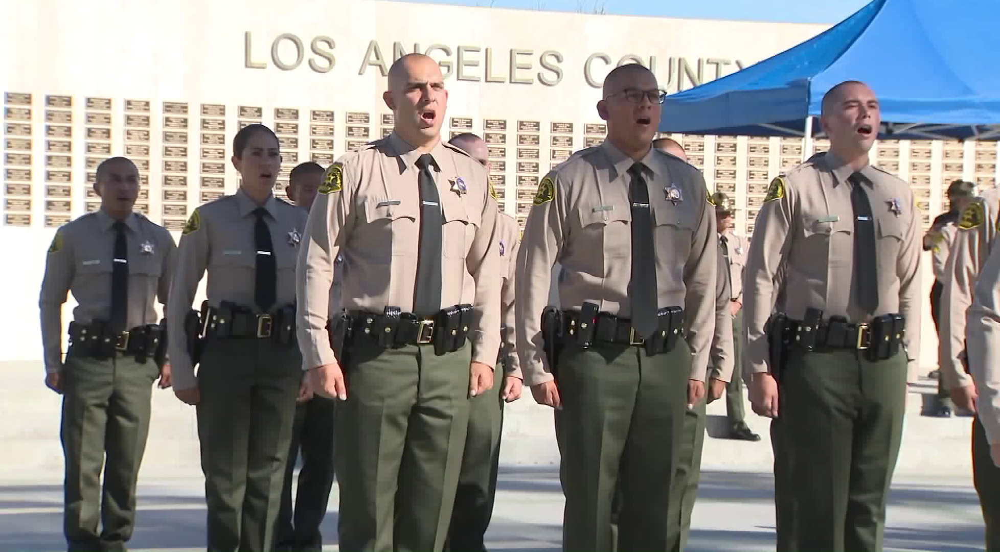 Joseph Blair, left, walks in formation with other L.A. County Sheriff's deputies on July 5, 2018. (Credit: KTLA)