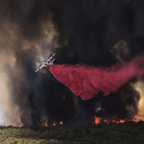 An air tanker drops retardant on the Benton Fire in Riverside County on July 2, 2018. (Credit: Cal Fire/Riverside County Fire Department)