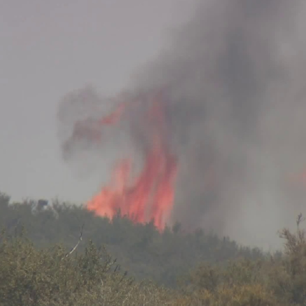 A blaze burns near the Cajon Pass in San Bernardino County on July 6, 2018. (Credit: KTLA)
