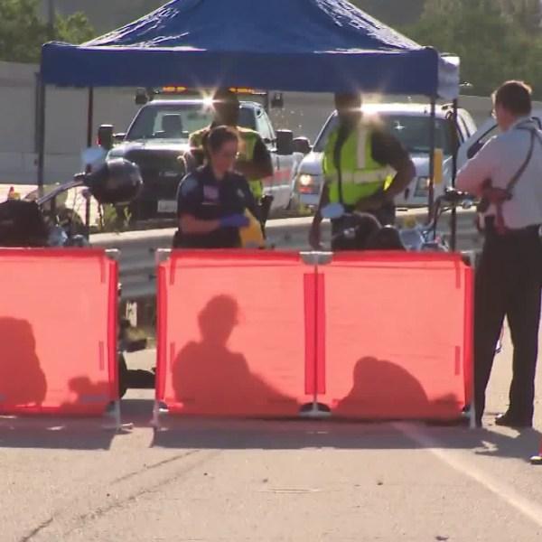 Authorities investigate a fatal shooting on the 210 Freeway in San Bernardino on July 6, 2018. (Credit: KTLA)