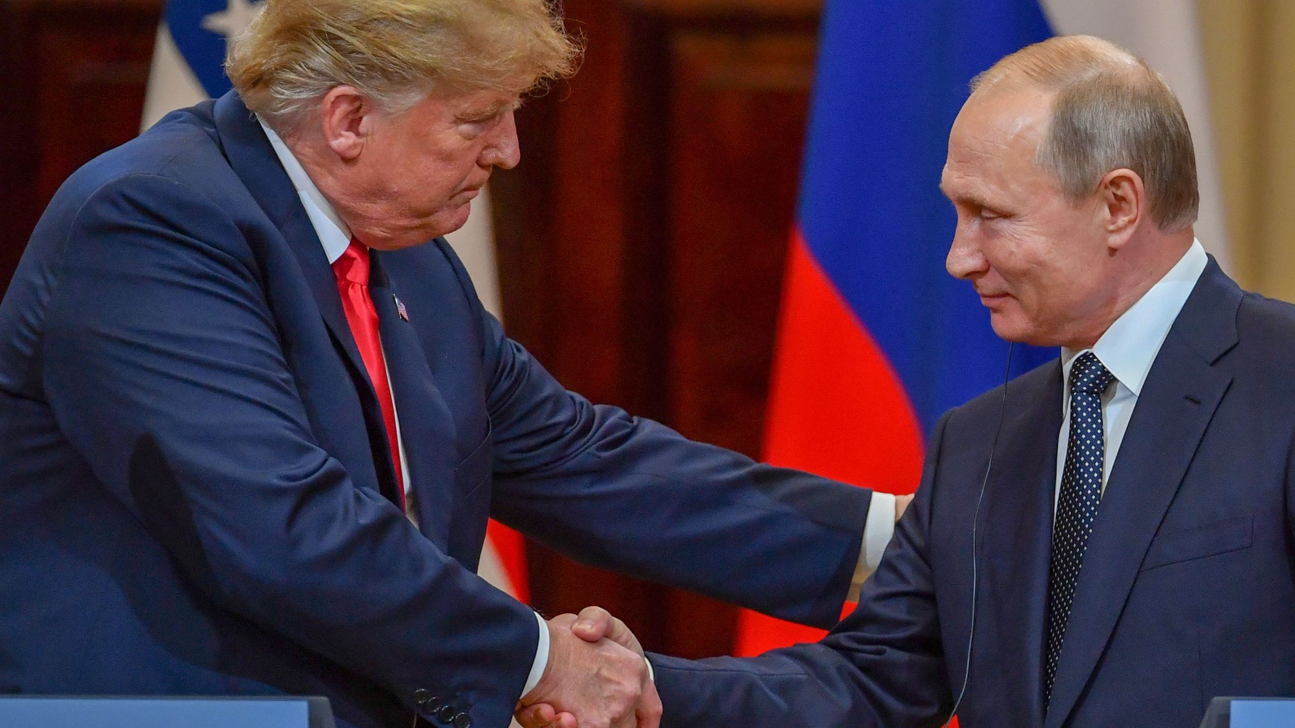 US President Donald Trump and Russia's President Vladimir Putin shake hands before attending a joint press conference after a meeting at the Presidential Palace in Helsinki, on July 16, 2018. (Credit: YURI KADOBNOV/AFP/Getty Images)