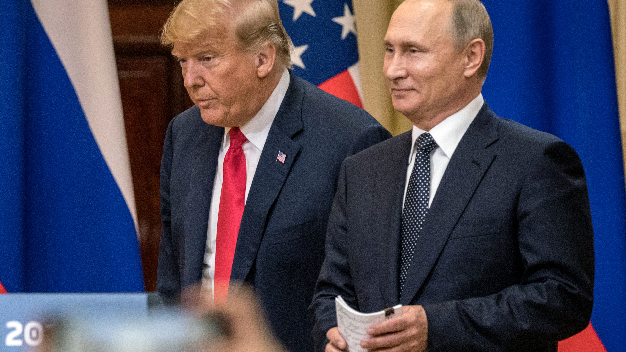 U.S. President Donald Trump, left, and Russian President Vladimir Putin arrive to waiting media during a joint press conference after their summit on July 16, 2018, in Helsinki, Finland. (Credit: Chris McGrath/Getty Images)