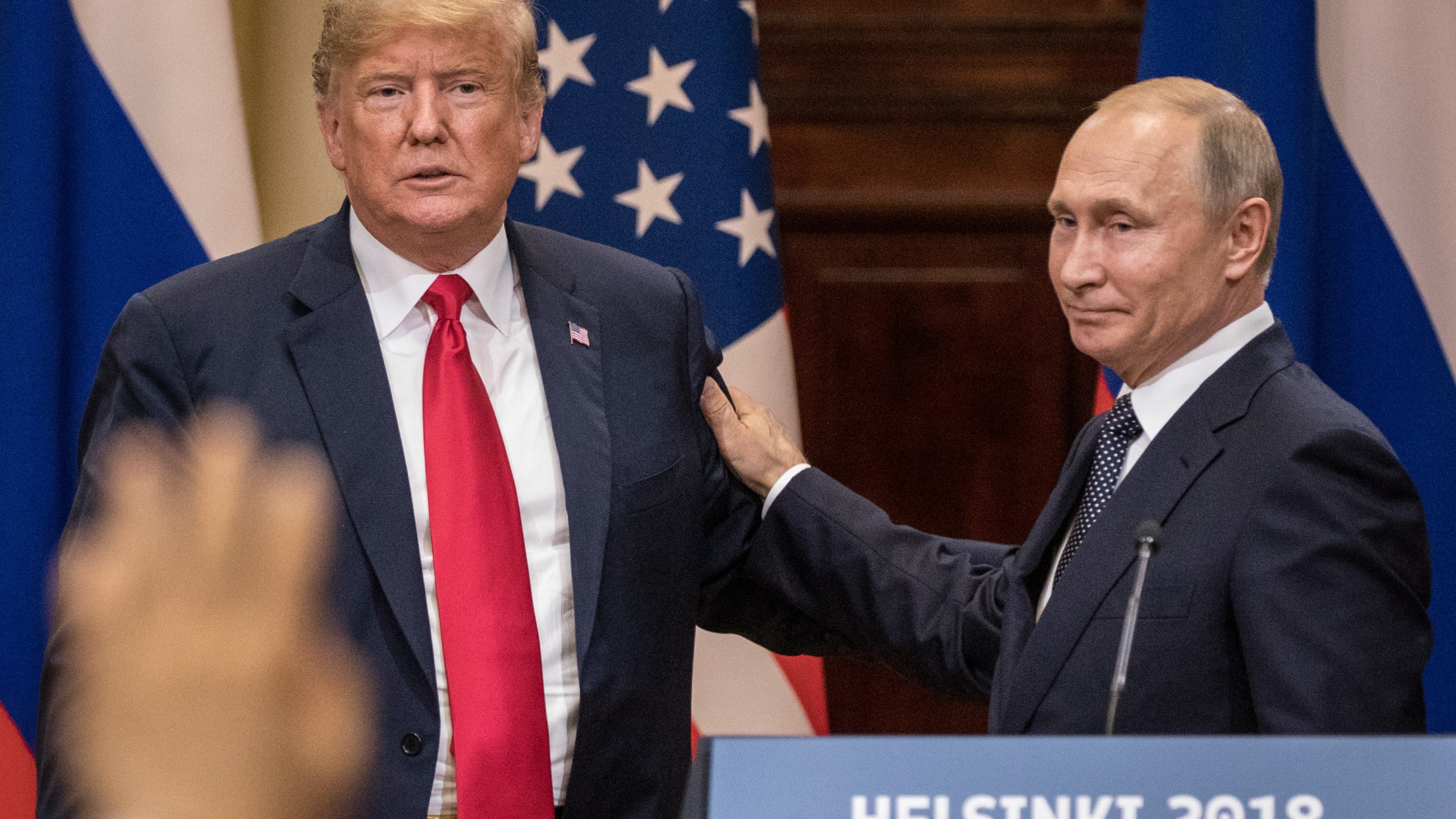U.S. President Donald Trump, left, and Russian President Vladimir Putin shake hands during a joint press conference after their summit on July 16, 2018, in Helsinki, Finland. (Credit: Chris McGrath/Getty Images)