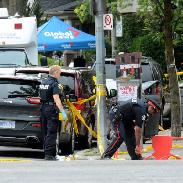 Police investigate the scene of a shooting from the night before in Toronto, Ontario, Canada on July 23, 2018. (Credit: USMAN KHAN/AFP/Getty Images)