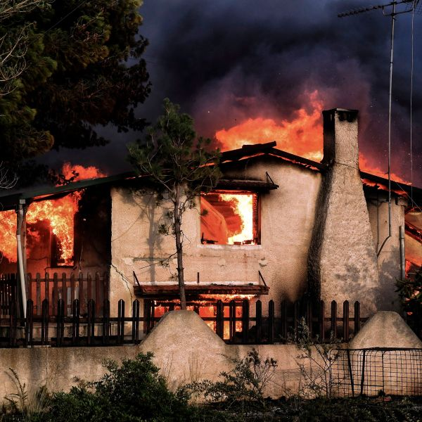 A house burns during a wildfire in Kineta, Greece, near Athens, on July 23, 2018. (Credit: Valerie Gache / AFP / Getty Images)