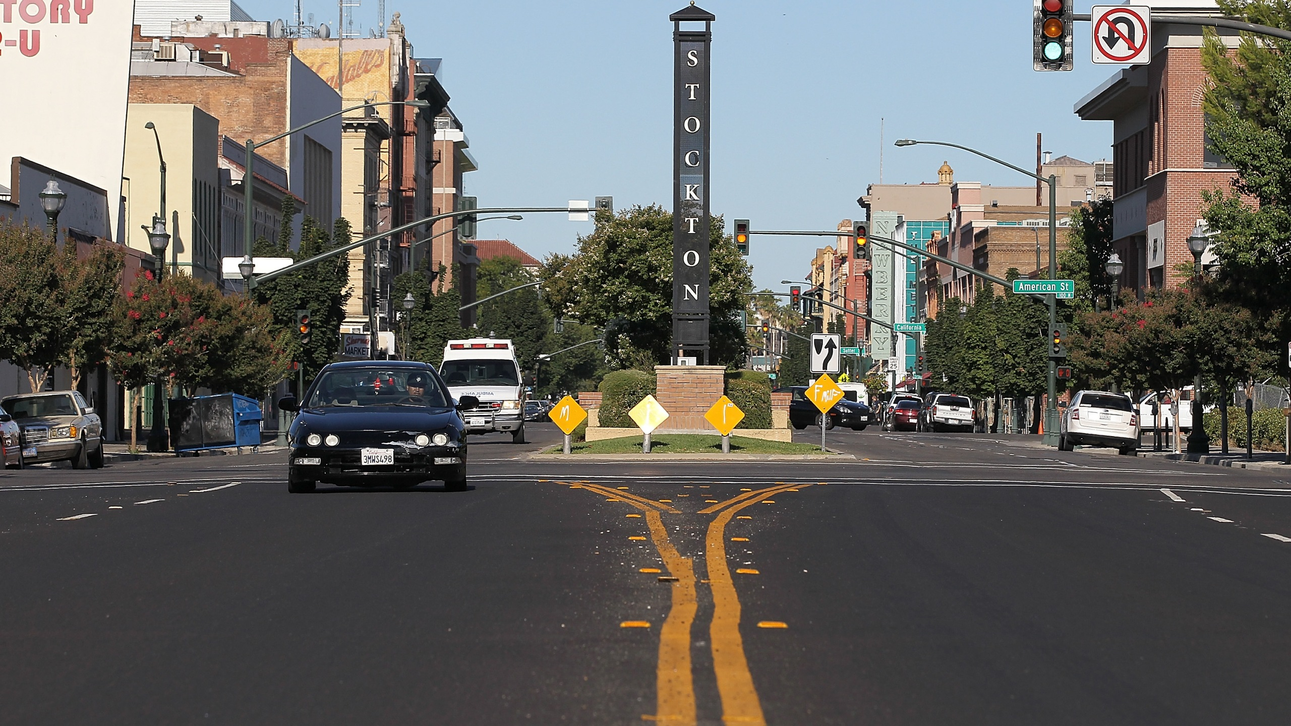 Cars drive by a sign on June 27, 2012, in Stockton, Calif. (Credit: Justin Sullivan/Getty Images)