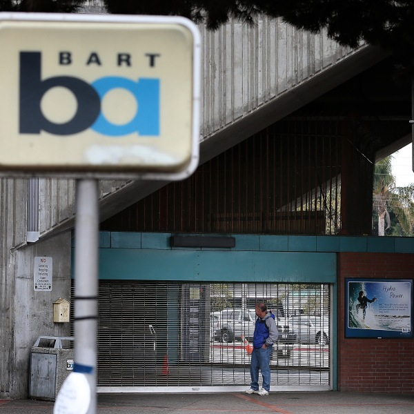 A man looks into the shuttered Bay Area Rapid Transit (BART) West Oakland station on October 21, 2013 in Oakland, California. (Credit: Justin Sullivan/Getty Images)